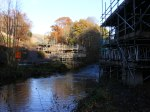 Looking north across Gala Water showing the scaffolding that is currently covering the bridge abutments.