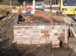The bay platform wall now with a completed course of engineering bricks.