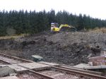 A view which illustrate just how large a job it is to  cut back the hill-side and allow access to the bay platform.