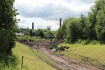 The view from the site of the old Newtongrange station, with the footbridge under construction in the middle distance and the winch gear of Lady Victoria colliery in the background.