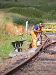 Jim drilling a couple of holes in a rail-end and re-fixing the fishplates.