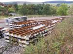 Piles of pre-fabricated sections of rails which will be used as gather rails on viaducts and bridges. (Thanks to my pw guru for help with identifying these items.