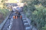 The track-bed under bridge OB011/013 Melville Road having final works done before the sleepers visible are laid out.