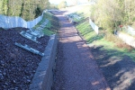 The neatly prepared track-bed viewed from OB011/025 Station Road at Gorebridge.