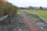 The view south towards Redhaugh bridge, note the high mesh fencing seen all along this stretch of the railway.