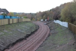 Looking north from the second footbridge FB011/018A, located at the site of the old Newtongrange station. Ongoing work can be seen to install the new mesh fencing. Newbattle viaduct is just out of sight around the curve.