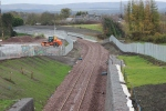 The track curving over the new Hardengreen roundabout viaduct.