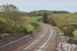 Looking south towards Borthwick bank, from bridge OB011/030.