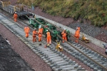The track-laying team working to get the last rails down.