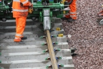 The second rail falls into position on the sleepers.