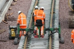 As it travels along it will stop near the sets of rollers, lifting the rails to allow the rollers to be removed.