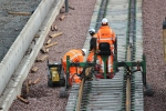 Once the rollers are removed the rails are lowered back into the housing on the sleepers ready for the clips to be pushed into place and the track to be used.