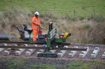 The front end of the rails with the small supporting vehicle,ensuring the rails locate on the rollers as it is fed out.