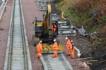 Some of the last sleepers on the loop line being lowered in place near Willowburn bridge.