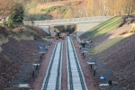 The new OB011/036A Willowburn bridge seen from Tynehead, with the track-laying gang visible below the bridge.