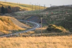The curve which carries the railway towards Falahill captured in the late Autumn sunshine. A number of contractors can be seen heading up towards the A7 at the end of their shift.