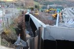The new retaining wall that has been built along the road that passes over  the railway just north of the station.