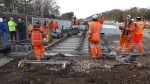 The track-laying team at Tweedbank on the 5/2/15, dropping the last length of rail (for now??) in place.