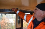 Tom at work in the cab of the Ruston, giving the paint work a touch up.