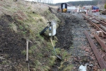Work underway to dig out a ditch alongside the bay platform access track.