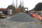 The latest pile of aggregate that will be used to cover the newly installed drainage system.
