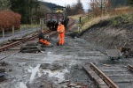 Iain and Jim grab a minute between loads as the area giving access to the bay platform starts to get back into shape.