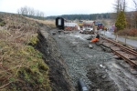 The trench along the access to the bay with pipe laid and partially back-filled.