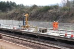 The coping stones have been laid along the platform. The piece of plant on the platform is used for lifting the coping stones to allow them to be lowered into place.