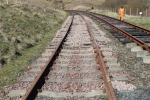 The main running line north of the crossing with a fresh ballast drop.
