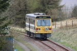 The railbus about to disappear around the corner on a passenger run.