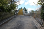 Showing clearly why it was not practical to rebuild the bridge as a road bridge. The new pedestrian footbridge at Plumtreehall Brae.
