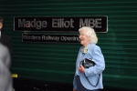 Madge seen in front of the newly unveiled nameplates