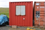 Work started on the office container, with one end recieving the first coat of primer.