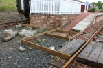 The shuttering in place at the end of the platform to provide improved access.