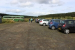 The shuttle bus and a number of cars in the car park during the running weekend.