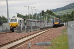 Both platforms are full at Tweedbank, with the Royal train in one and a couple of 170 dmu's in the other.