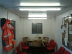 The office /mess room with the lights on. The return of power around the site.
