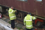 Davie and Chris working on the underframe of the buffet coach.