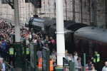 Surrounded by admirers and tv cameras, the Flying Scotsman proves a major attraction at the station