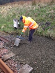Peter tidying up the current end of the drains from the bay platform area.