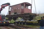 Both cranes gently work the brake into position over the rails.